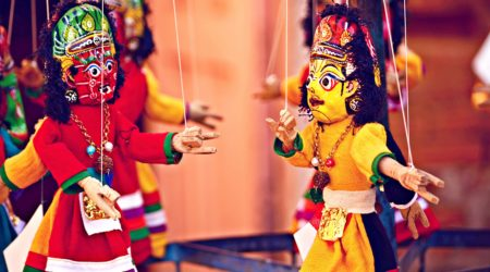 Picture of two Indian style dancing puppets