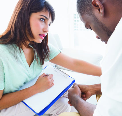 Young woman professional talking to depressed young man