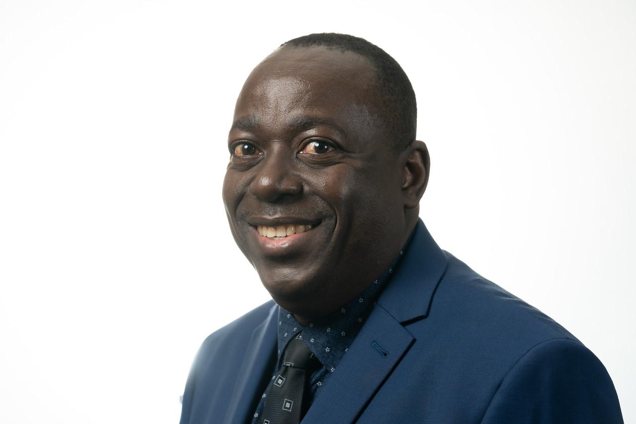 Portrait photo of Patrick Kwesiga